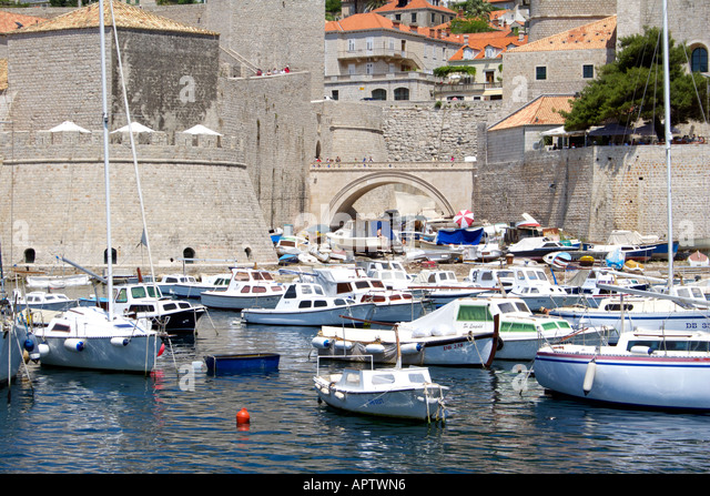 Pleasure boats moored in Dubrovnik harbour Pleasure boat yacht moored Dubrovnik harbour harbor city boat Croatia - Stock Image