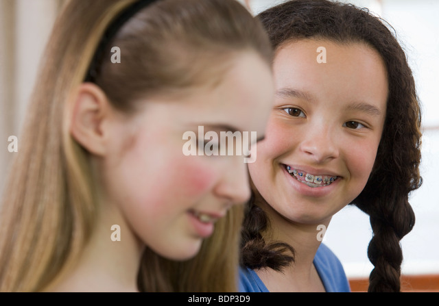 Close-up of two girls smiling - Stock Image