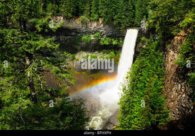 Brandywine Falls with rainbow at Brandywine Falls Provincial Park between Squamish and Whistler, BC - Stock Image