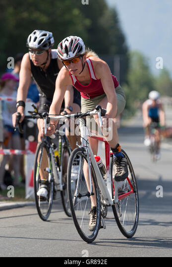 Young Woman Fights At A Triathlon For A Good Ranking - Stock Image