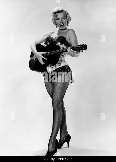 Marilyn Monroe playing guitar - Stock Image