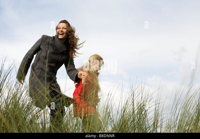 Mother and daughter outdoors - Stock Image