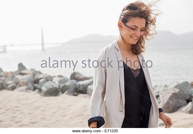 Woman walking, Golden Gate Bridge in background. San Francisco, California - Stock Image