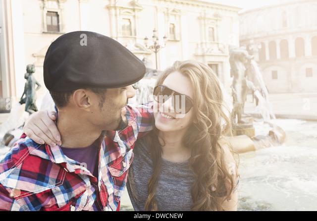 Tourist couple, Plaza de la Virgen, Valencia, Spain - Stock Image