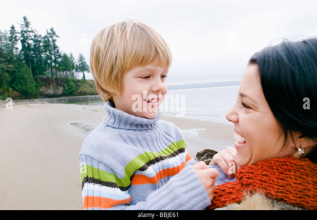 Young woman and boy at beach, Vancouver, British Columbia - Stock Image