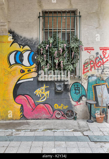 Istanbul, Turkey - April 18, 2017:  Abandoned gruge wall with closed window and colorful graffiti near Istiklal - Stock Image
