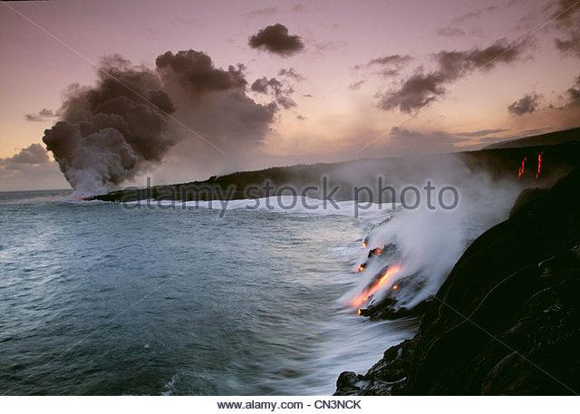 Lava flows entering the ocean, Hawaii Volcanoes National Park, Hawaii - Stock Image