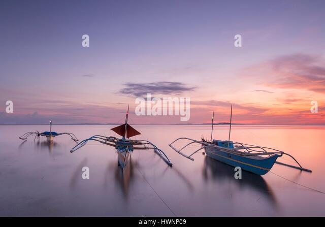 Philippines, Luzon, Sorsogon Province, Donsol, fishing boat in Pangpang at twilight - Stock-Bilder