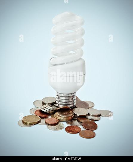 Eco lighbulb concept and money savings on energy - Stock Image