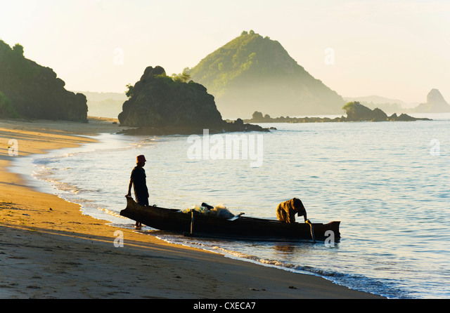 Fisherman returning to Kuta Beach with his daily catch, Kuta Lombok, Indonesia, Southeast Asia, Asia - Stock Image