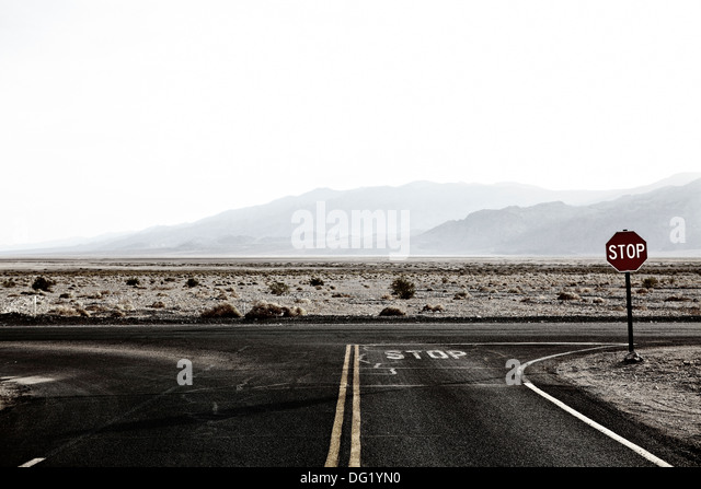 Stop Sign at Desert Crossroad, Nevada, USA - Stock Image