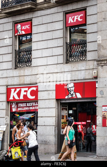 Spain Europe Spanish Hispanic Madrid Centro Kentucky Fried Chicken KFC restaurant fast food front entrance - Stock Image