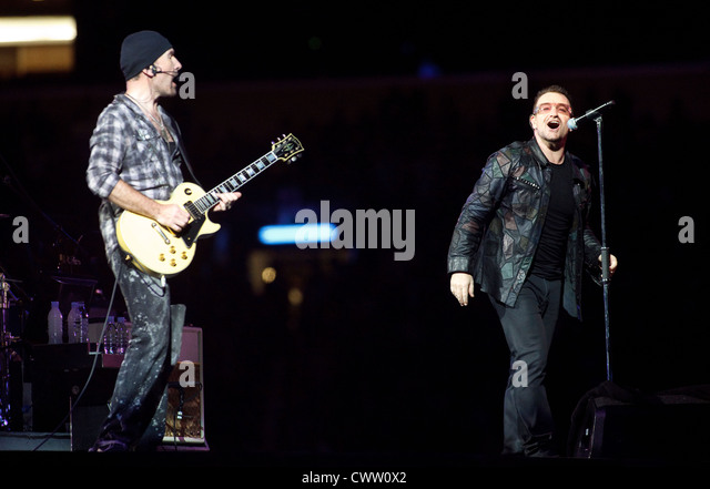 The Edge and Bono performing during The U2 360° Tour - Stock Image