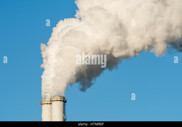 The pipe of a coal power plant with white smoke as a global warming concept. - Stock Image
