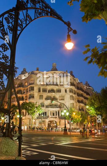 Casa Mila by Gaudi at twilight, laterne,Passeig de Gracia, - Stock Image