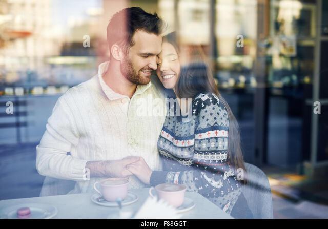 Amorous dates enjoying rest in cafe - Stock Image