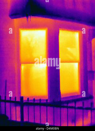 Thermal image of windows of house - Stock Image