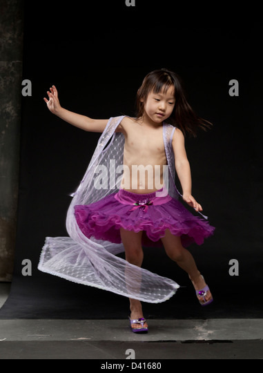 Young Asian Twin Girls Playing - Stock Image
