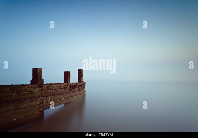 A wooden groyne pointing out to sea at Milford on Sea, Hampshire, UK - Stock Image