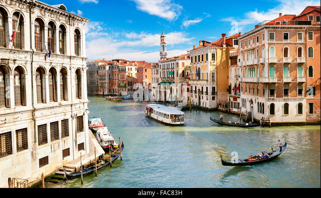 Gondola and waterbus on Grand Canal (Grande Canal), Venice, Italy, UNESCO - Stock Image