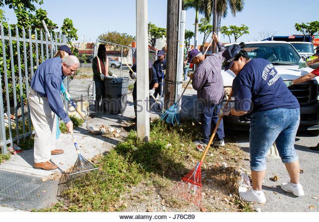 Miami Florida Little Havana community clean-up volunteer resident collect trash garbage Hispanic man woman Miami - Stock Image