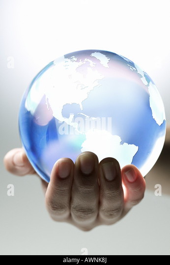 A person holding planet earth - Stock Image