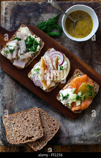 Scandinavian sandwiches with smoked mackerel, herrings and salmon - Stock Image
