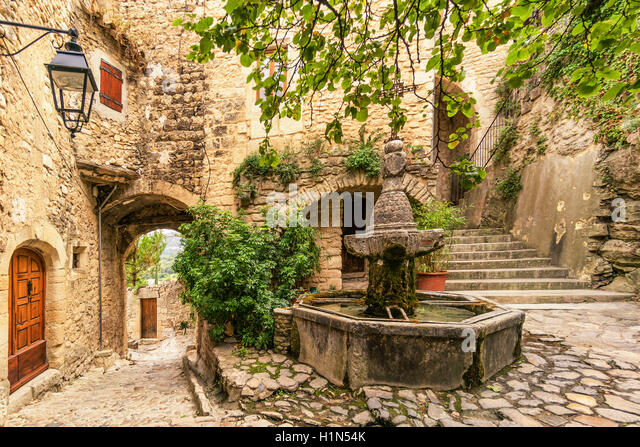 Historic Fountain in courtyard, Le Crestet, Vaucluse, France, Europe - Stock Image