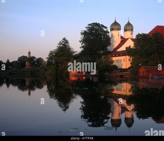 Church at riverside, Seeon Abbey, Bavaria, Germany - Stock Image