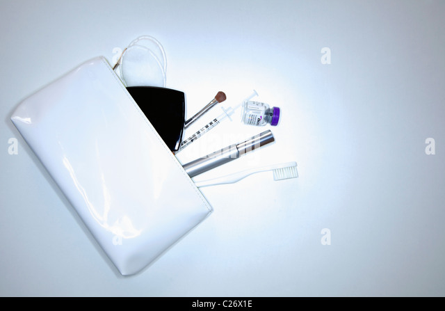 White Purse and its Contents - Stock Image