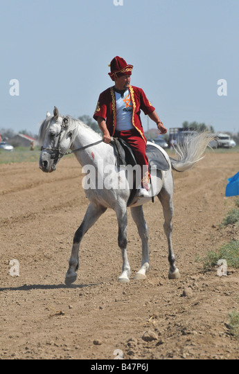 The Annual Atyrau Horse race attracts many competitors and spectators. Standards of horses and riders vary widely. - Stock-Bilder