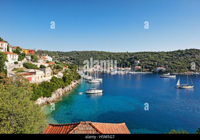 Sailing boats at the port of Kioni in Ithaki island, Greece - Stock Image