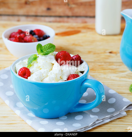 cottage cheese and ripe berries, food closeup - Stock Image