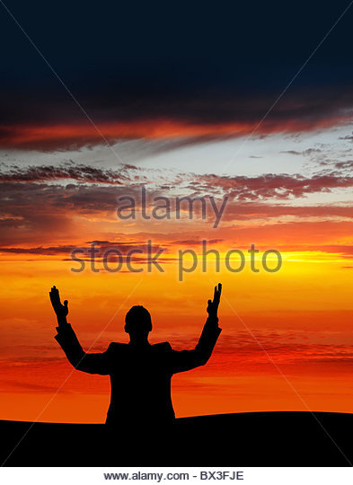 Man silhouette at Sunset - Stock Image