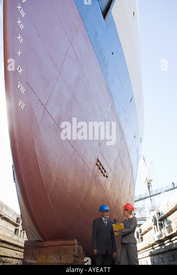Engineers by ship - Stock Image