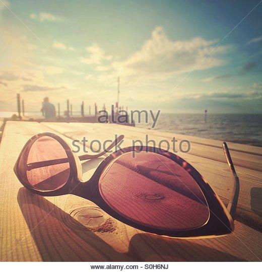 Sunny summers evening, sunglasses - Stock Image