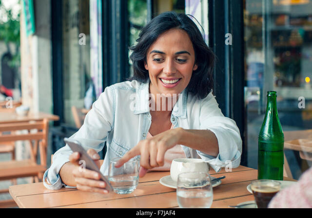 Woman looking at smartphone - Stock Image