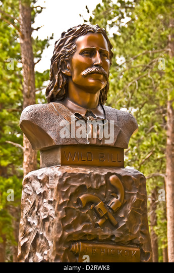 Monument bust of famous Wild Bill Hickok at his grave at Boot Hill (or Mt. Moriah Cemetery) in Deadwood, South Dakota - Stock Image