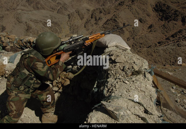 An Afghan National Army soldier uses a Dragunov sniper rifle during a demonstration to display weaponry and communicatons - Stock Image