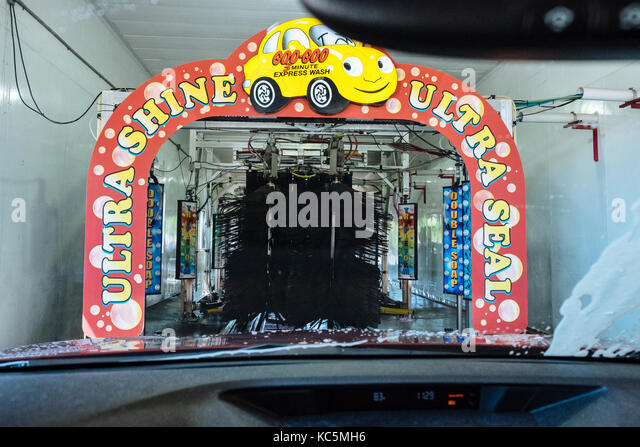 Driving through a Goo Goo automated car wash, Montgomery Alabama, USA. - Stock Image