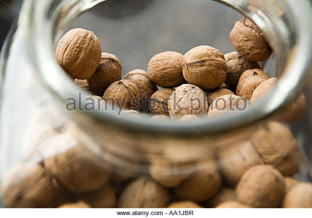 Walnuts in a jar - Stock Image