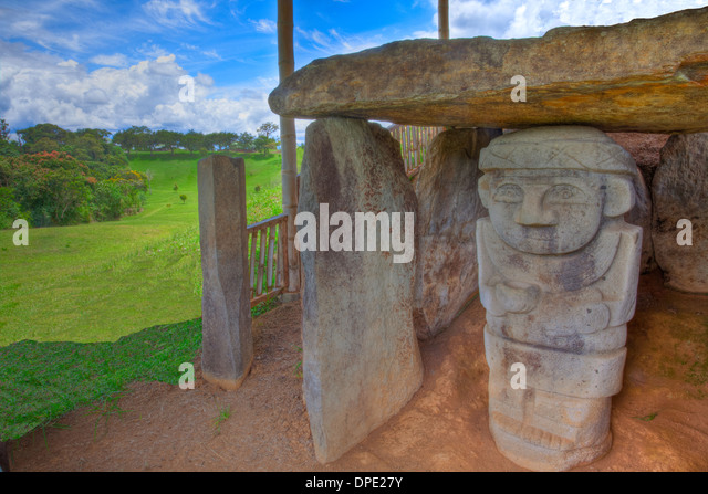 Statue under dolmen The Mountain of the Idols Archaeological Park Colombia Ancient dolmen 3,000 years old from unknown - Stock Image