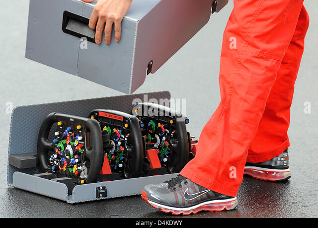 A man closes the transportation box for the steering wheels of the Toyota racing cars at Nurburgring in Nuerburg, - Stock Image