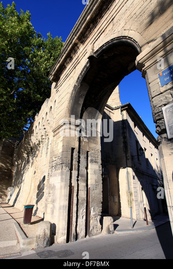 The fortification and a door around the city of Avignon. - Stock Image
