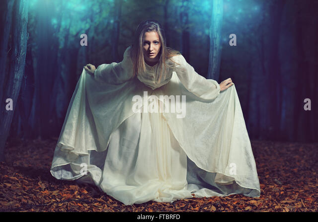 Beautiful woman bowing in ethereal fairy forest . Fantasy and surreal - Stock-Bilder