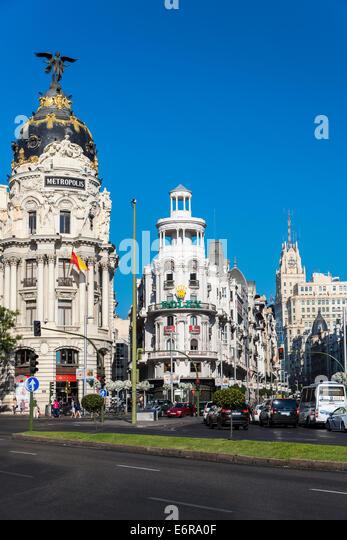Gran Via street and Metropolis Building, Madrid, Comunidad de Madrid, Spain - Stock Image