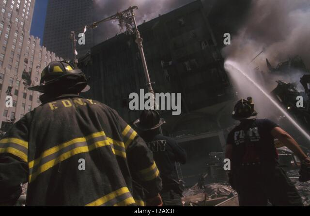Fire fighter at World Trade Center site following September 11th terrorist attack. The stream water is to the still - Stock-Bilder