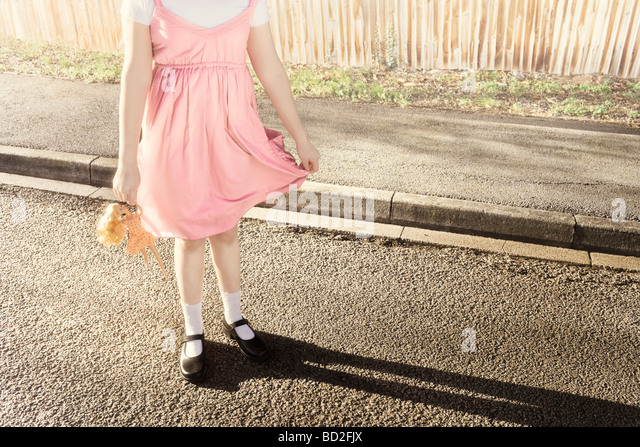 Abstract girl posing holding doll - Stock-Bilder