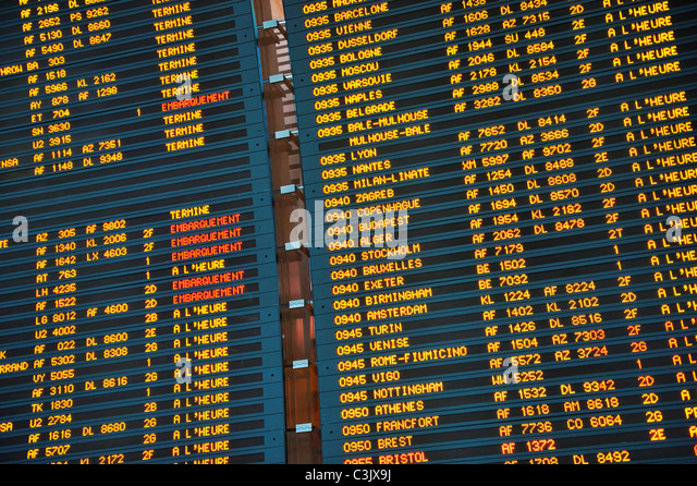 Arrival / departure board at Paris Charles de Gaulle International Airport, France - Stock Image