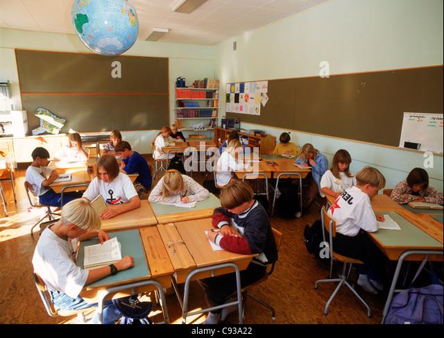 Elementary Classrooms Writing ~ Elementary students floor sitting stock photos